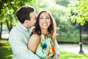 a couple laughs at a secret whispered in huntsville alabama engagement session