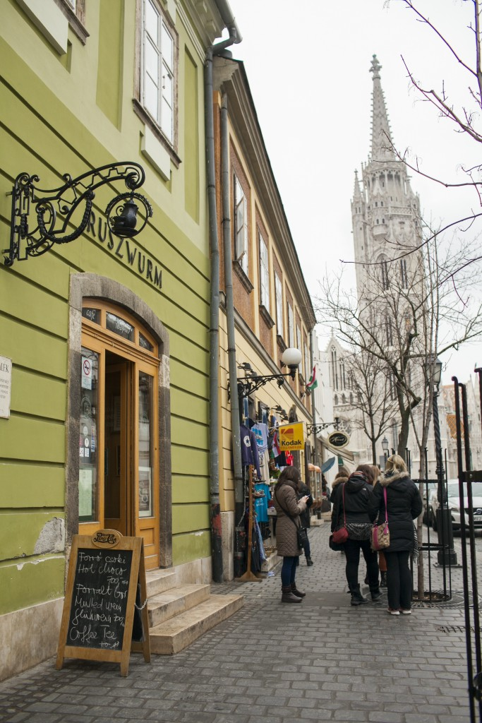 entrance to Ruszwurm cafe with matthias steeple in background