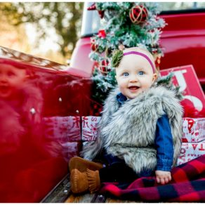christmas themed shoot with little girl in fur vest in gravel road tradition
